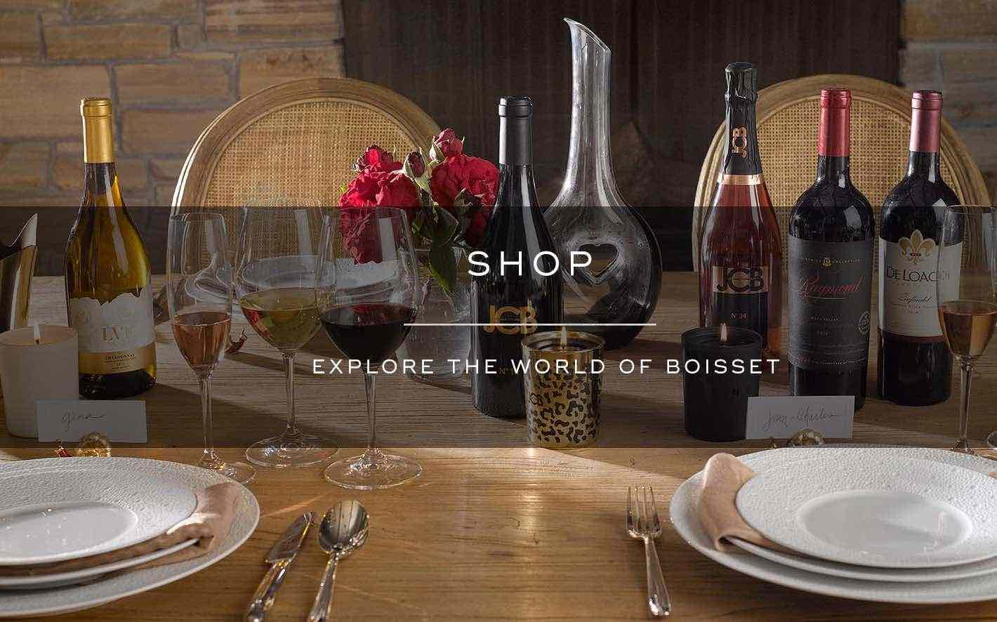 Photo of a table display of organic, biodynamic and sustainable wines, decanters and crystal stemware available in our wine shoppe