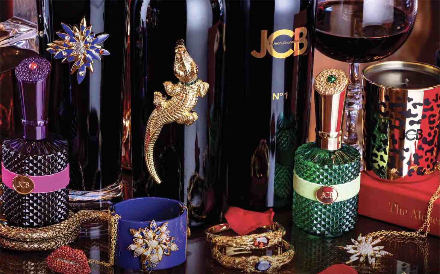 luxury wine gifts for corporate gifting and holiday gifts, plus room sprays, fragrances and wine-inspired jewelry on a table top
